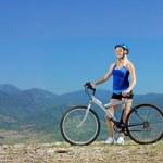 Female biker riding mountain bike — Stock Photo #45865957