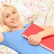 Girl holding notebook — Stock Photo #45866377