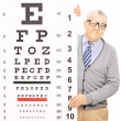 Senior man behind eyesight test — Stock Photo #45866851