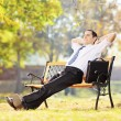 Businessperson on a bench and relaxing — Stock Photo #45867779