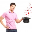 Man holding hat and hearts coming out — Stock Photo #45868425