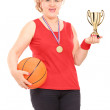 Woman holding trophy and basketball — Stock Photo #45868833