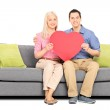 Couple holding big red heart — Stock Photo #45869083