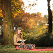 Woman reading book in park — Stock Photo #45869173