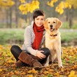 Beautiful woman and his dog (Labrador retriever) — Stock Photo #45869453
