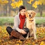 Beautiful woman and his dog (Labrador retriever) — Stock Photo