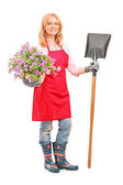 Female gardener holding shovel — Stock Photo
