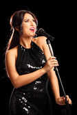 Glamorous young woman singing — Stock Photo