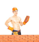 Shirtless muscular male construction worker — Stock Photo