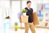 Man with boxes moving in an apartment — Stock Photo