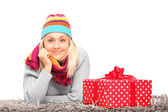 Female lying near gift — Stock Photo