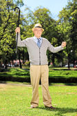 Man gesturing happiness in park — Stockfoto