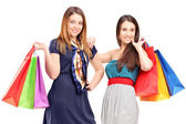 Females holding shopping bags — Stock Photo