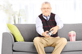 Senior man playing video games — Stock Photo