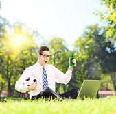 Man watching football on laptop — Stock Photo
