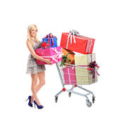 Female holding gifts and shopping cart — Stockfoto