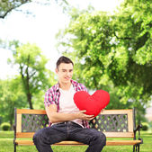 Guy holding red heart — Stock Photo