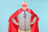 Mature superhero on blue background — Stock Photo