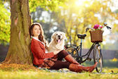 Female on a grass with dog — Stock Photo