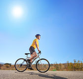 Male with helmet riding a bike — Stock Photo