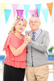 Couple singing on microphone — Stock Photo