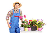Florist posing next to flowers — Stock Photo