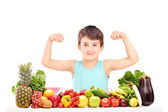 Child showing his muscles — Stock Photo