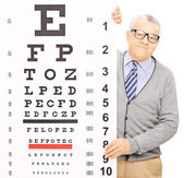 Senior man behind eyesight test — Stock Photo