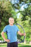 Man holding hulahoop — Stok fotoğraf