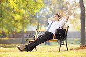 Businessperson on a bench and relaxing — Stock Photo