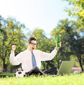 Man cheering and watching soccer on laptop — Stock Photo