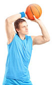 Basketball player about to score point — Stockfoto