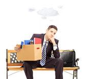 Sad businessman holding box — Zdjęcie stockowe