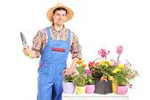 Male gardener holding spade — Stock Photo
