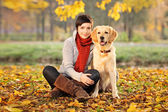 Beautiful woman and his dog (Labrador retriever) — Stock Photo