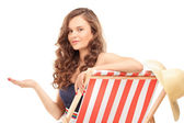 Woman sitting on sun lounger — Stock Photo
