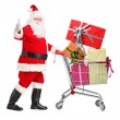 Santa Claus pushing shopping cart — Stock Photo #45874179