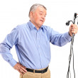 Confused senior holding electronic cables — Stock Photo #45876587