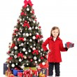 Girl next to christmas tree — Stock Photo #45870523