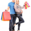 Couple holding shopping bags — Stock Photo #45871563