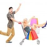 Person pushing woman in shopping cart — Stock Photo #45872429