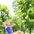 Woman exercising  in a park — Stock Photo #45874375