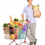 Man next to shopping cart — Stock Photo #45875847