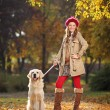 Woman with dog in park — Stok fotoğraf #45875971