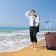 Businessman with luggage searching way — Stock Photo