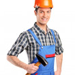 Manual worker holding a hammer — Stock Photo #45876373