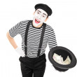 Mime artist collecting money in hat — Stock Photo