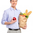 Man holding bag with bread and vegetables — Stock Photo #45877189
