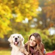 Female in park with dog — Stock Photo #45877259