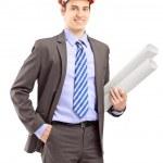Male holding blueprints — Stock Photo #45877481